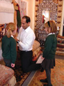 Anas helps schoolchildren weave at The Oriental Rug Gallery ltd