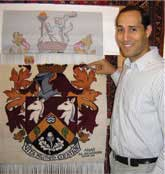 Anas weaving Haslemere Coat of Arms at The Oriental Rug Gallery