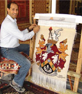 Anas weaving the Coat of Arms at The Oriental Rug Gallery Ltd